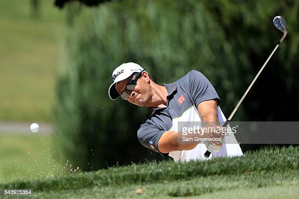 Adam Scott of Australia plays a shot on the fifth hole during the first round of the World Golf Championships Bridgestone Invitational at Firestone...