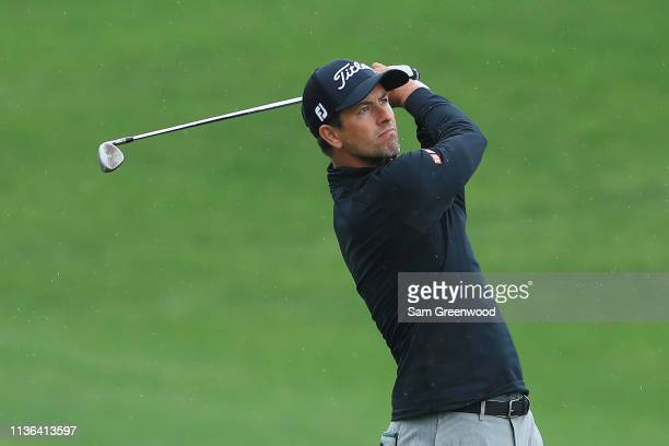 Adam Scott of Australia plays a shot on the fourth hole during the final round of The PLAYERS Championship on The Stadium Course at TPC Sawgrass on...