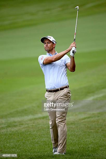 Adam Scott of Australia plays a shot on the tenth hole during the first round of the Valspar Championship at Innisbrook Resort Copperhead Course on...