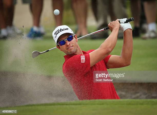Adam Scott of Australia plays a shot out of a bunker on the third hole during day three of the Australian Masters at The Metropolitan Golf Course on...