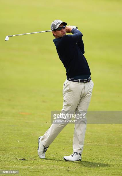 Adam Scott of Australia plays an approach shot from the fairway during round two of the 2013 Australian Masters at Royal Melbourne Golf Course on...