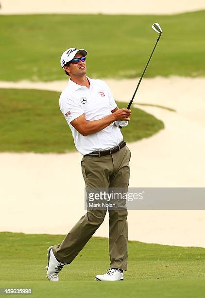 Adam Scott of Australia plays an approach shot on the 10th hole during day one of the 2014 Australian Open at The Australian Golf Course on November...