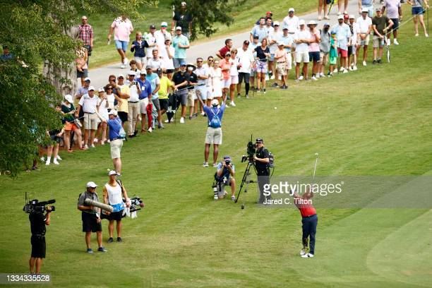 Adam Scott of Australia plays an approach shot on the 18th hole during the final round of the Wyndham Championship at Sedgefield Country Club on...