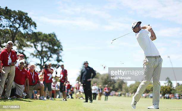 Adam Scott of Australia plays an approach shot on the 8th hole during day four of the 2013 Australian Open at Royal Sydney Golf Club on December 1...