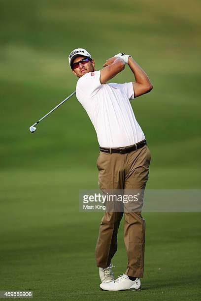 Adam Scott of Australia plays an iron shot ahead of the 2014 Australia Open at The Australian Golf Course on November 26 2014 in Sydney Australia