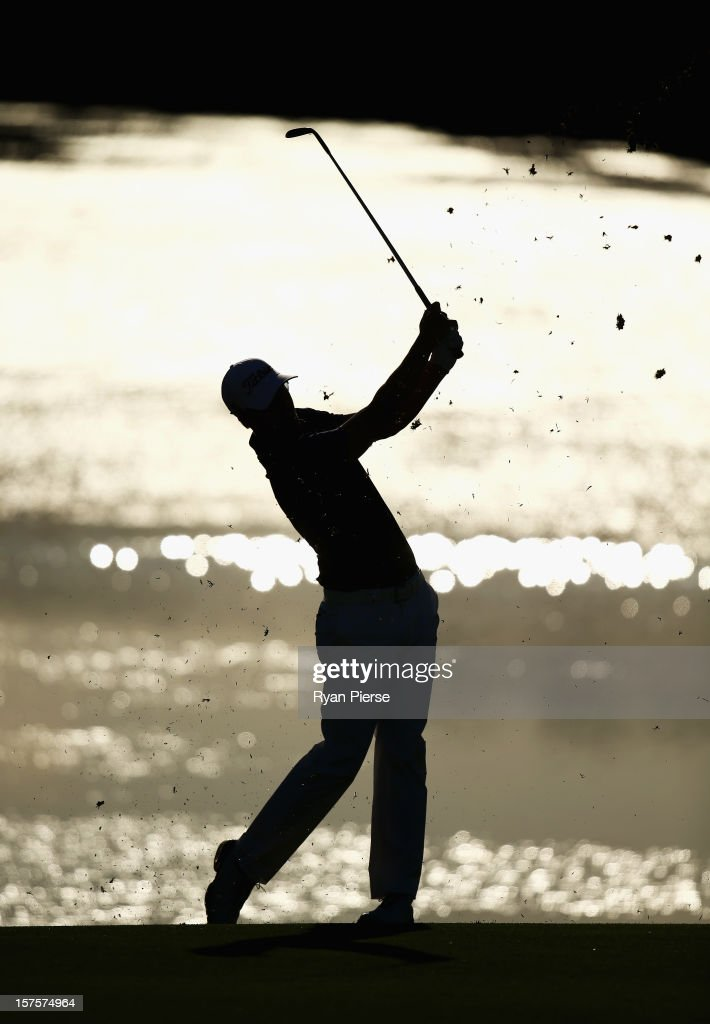 Adam Scott of Australia plays an iron shot during the Pro-Am ahead of the 2012 Australian Open, beginning tomorrow, at The Lakes Golf Club on December 5, 2012 in Sydney, Australia.