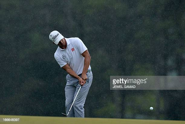 Adam Scott of Australia plays during the fourth round at the 77th Masters golf tournament at Augusta National Golf Club on April 14, 2013 in Augusta,...