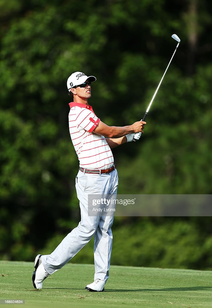Adam Scott of Australia plays his second shot on the 14th hole during round two of THE PLAYERS Championship at THE PLAYERS Stadium course at TPC Sawgrass on May 10, 2013 in Ponte Vedra Beach, Florida.