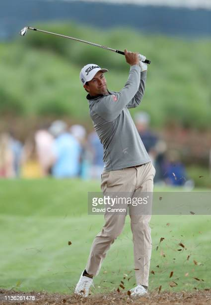 Adam Scott of Australia plays his second shot on the par 4, 18th hole during the third round of the 2019 Players Championship held on the Stadium...