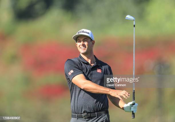 Adam Scott of Australia plays his second shot on the par 5 first hole during the third round of the Genesis Invitational at The Riviera Country Club...
