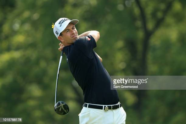 Adam Scott of Australia plays his shot from the 12th tee during the final round of the 2018 PGA Championship at Bellerive Country Club on August 12...