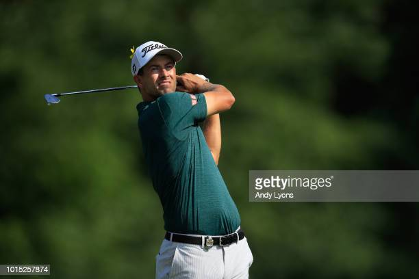 Adam Scott of Australia plays his shot from the 13th tee during the third round of the 2018 PGA Championship at Bellerive Country Club on August 11...