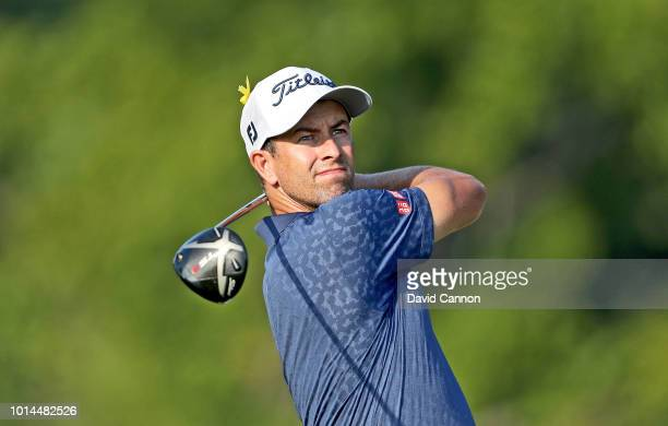 Adam Scott of Australia plays his tee shot on the 12th hole during the second round of the 100th PGA Championship at the Bellerive Country Club on...