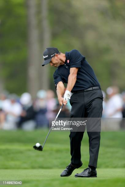 Adam Scott of Australia plays his tee shot on the 12th hole during the second round of the 2019 PGA Championship on the Black Course at Bethpage...