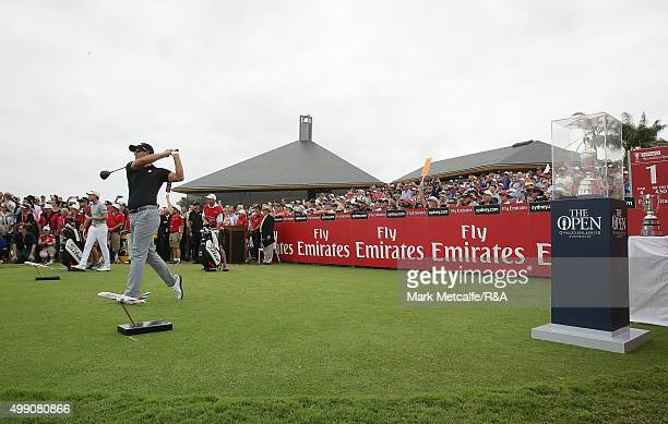 Adam Scott of Australia plays his tee shot on the 1st hole next to the Claret Jug during day four of the 2015 Australian Open at The Australian Golf...