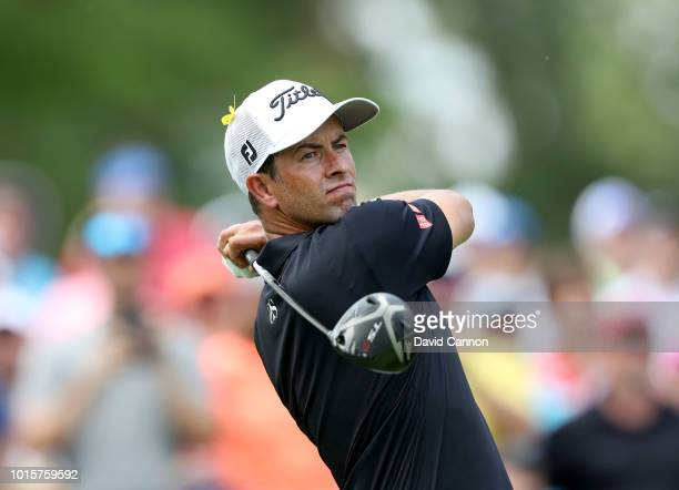 Adam Scott of Australia plays his tee shot on the fourth hole during the final round of the 100th PGA Championship at the Bellerive Country Club on...