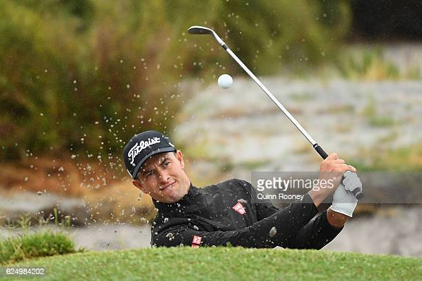 Adam Scott of Australia plays out of the bunker ahead of the 2016 World Cup of Golf at Kingston Heath Golf Club on November 22 2016 in Melbourne...