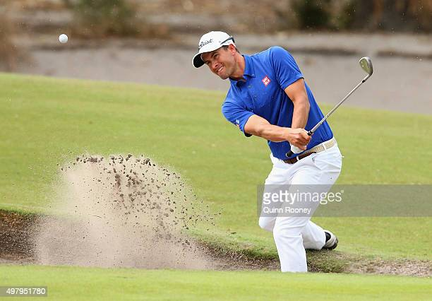 Adam Scott of Australia plays out of the bunker during day two of the 2015 Australian Masters at Huntingdale Golf Club on November 20, 2015 in...
