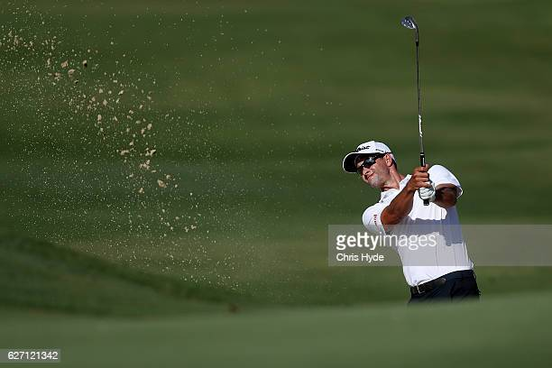 Adam Scott of Australia plays out of the bunker during day two of the 2016 Australian PGA Championship at RACV Royal Pines Resort on December 2, 2016...