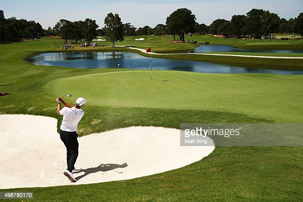 Adam Scott of Australia plays out of the bunker on the 9th hole during day one of the 2015 Australian Open at The Australian Golf Club on November 26...