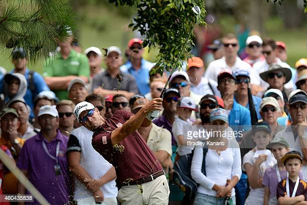 Adam Scott of Australia plays out of the rough on the 1st hole during day four of the 2014 Australian PGA Championship at Royal Pines Resort on...