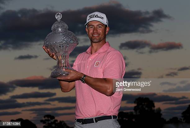 Adam Scott of Australia poses with the trophy after his one shot victory over Sergio Garcia following the final round of The Honda Classic at PGA...
