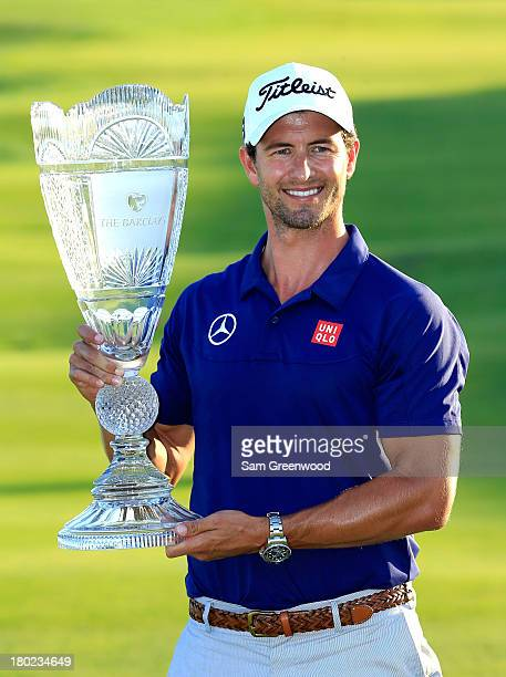Adam Scott of Australia poses with the trophy after winning The Barclays at Liberty National Golf Club on August 25 2013 in Jersey City New Jersey