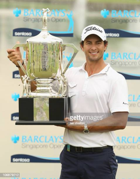 Adam Scott of Australia poses with the trophy after winning the Final Round of the Barclays Singapore Open at Sentosa Golf Club on November 14 2010...