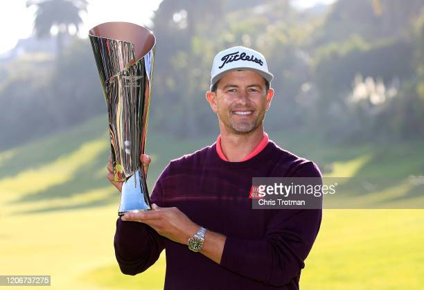 Adam Scott of Australia poses with the trophy after winning the Genesis Invitational on February 16 2020 in Pacific Palisades California