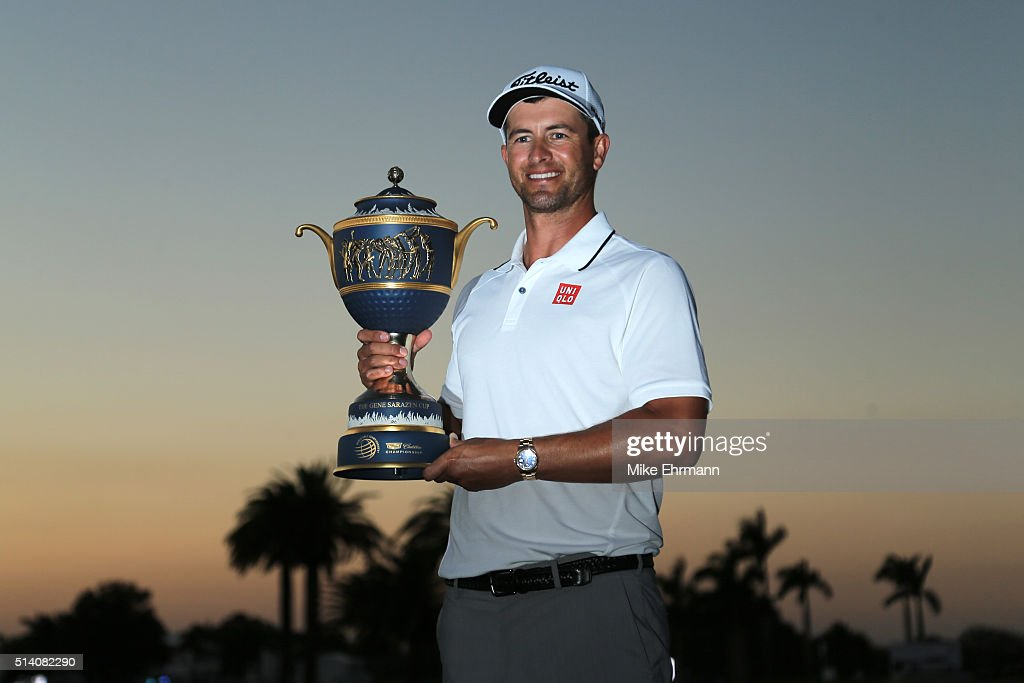 Adam Scott of Australia poses with the trophy on the 18th hole during the final round of the World Golf Championships-Cadillac Championship at Trump National Doral Blue Monster Course on March 6, 2016 in Doral, Florida.