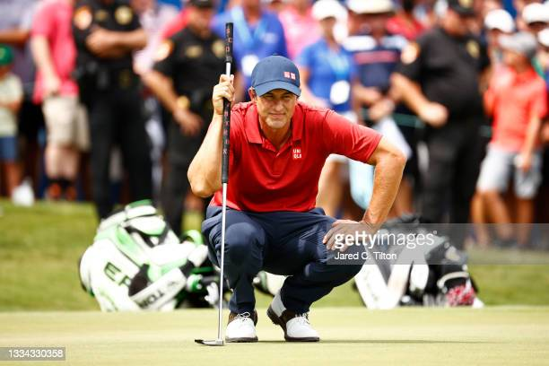 Adam Scott of Australia prepares to putt on the 18th green, the second-playoff hole in a six-way sudden-death playoff, during the final round of the...