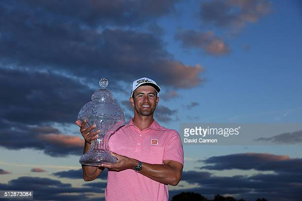 Adam Scott of Australia proudly holds the 2016 Honda Classic trophy after his one shot victory over Sergio Garcia of Spain during the final round of...