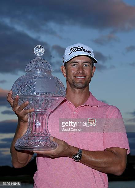 Adam Scott of Australia proudly holds the trophy after his one shot victory over Sergio Garcia during the final round of the 2016 Honda Classic held...