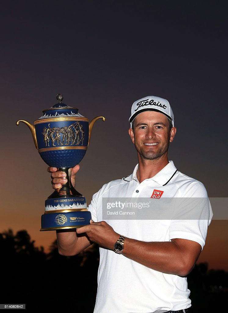 Adam Scott of Australia proudly holds the trophy after his one shot win in the final round of the 2016 World Golf Championship Cadillac Championship on the Blue Monster Course at the Trump National Doral Resort on March 6, 2016 in Doral, Florida.