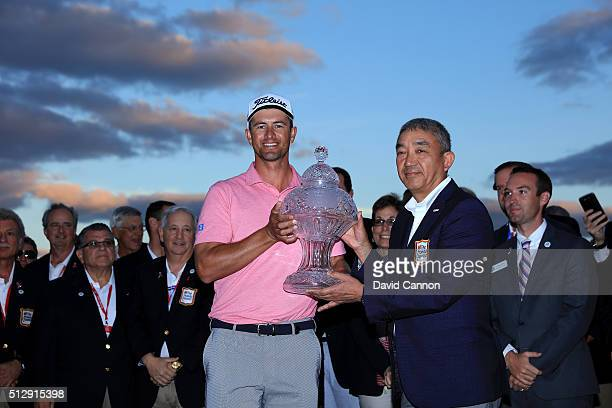 Adam Scott of Australia proudly is presented with the trophy after his one shot victory over Sergio Garcia during the final round of the 2016 Honda...