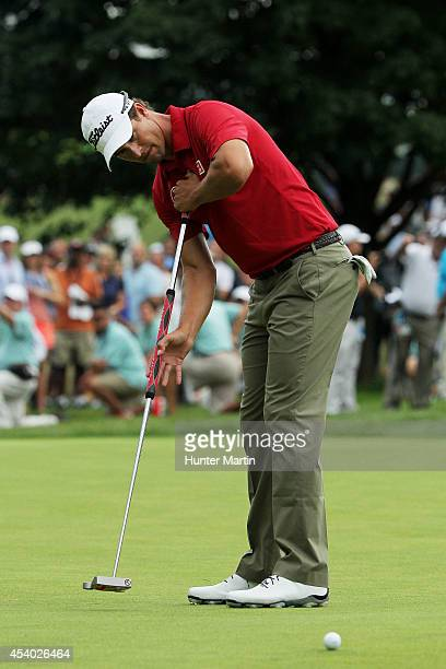 Adam Scott of Australia putts on the 18th green during the third round of The Barclays at The Ridgewood Country Club on August 23 2014 in Paramus New...