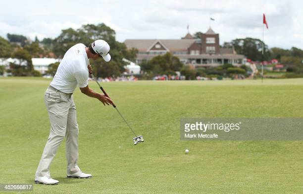 Adam Scott of Australia putts on the 1st hole during day four of the 2013 Australian Open at Royal Sydney Golf Club on December 1 2013 in Sydney...