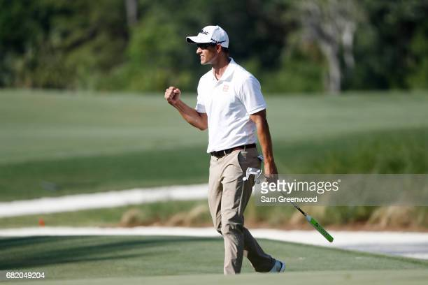 Adam Scott of Australia reacts after a birdie putt on the 14th green during the first round of THE PLAYERS Championship at the Stadium course at TPC...
