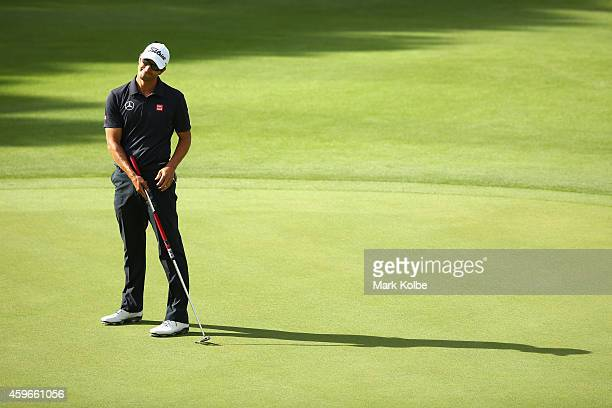 Adam Scott of Australia reacts after a missed putt during day two of the Australian Open at The Australian Golf Course on November 28 2014 in Sydney...