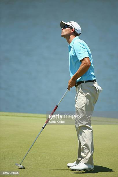 Adam Scott of Australia reacts after a missed putt on the 3rd hole during day four of the 2014 Australian Open at The Australian Golf Course on...