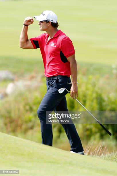 Adam Scott of Australia reacts after he hit in a chip shot for an eagle on the second hole during the final round of the Deutsche Bank Championship...