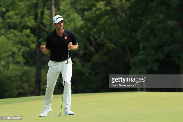 Adam Scott of Australia reacts after making a putt for birdie on the tenth green during the final round of the 2018 PGA Championship at Bellerive...