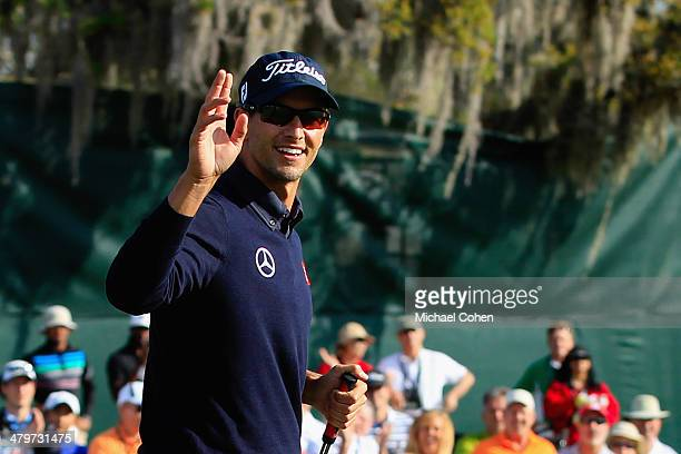 Adam Scott of Australia reacts after making a putt for birdie on the 15th hole during the first round of the Arnold Palmer Invitational presented by...