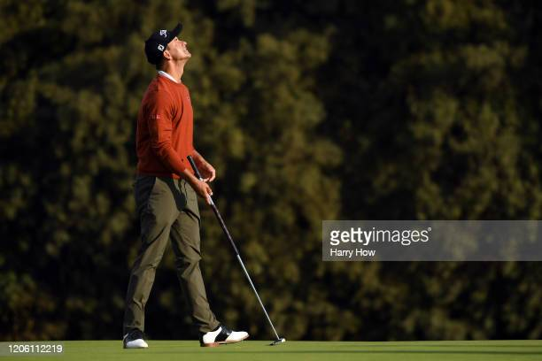 Adam Scott of Australia reacts after missing a birdie putt on the eighth green during the first round of the Genesis Invitational on February 13 2020...
