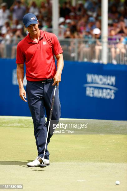 Adam Scott of Australia reacts after missing a putt for birdie on the 18th green, the first-playoff hole in a six-way sudden-death playoff, during...