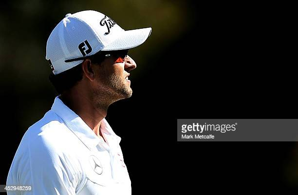 Adam Scott of Australia reacts after missing a putt on the 18th hole during day four of the 2013 Australian Open at Royal Sydney Golf Club on...