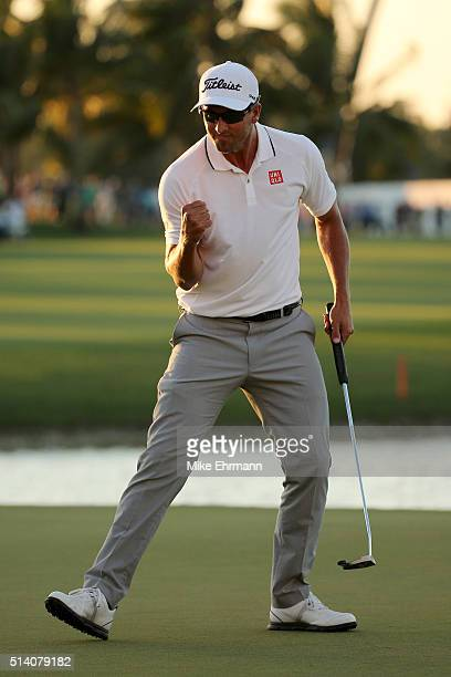 Adam Scott of Australia reacts after putting in to win on the 18th hole during the final round of the World Golf ChampionshipsCadillac Championship...