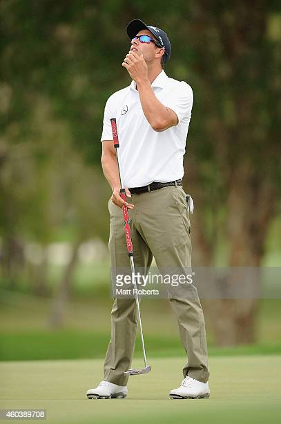 Adam Scott of Australia reacts on the 4th green during day three of the 2014 Australian PGA Championship at Royal Pines Resort on December 13, 2014...