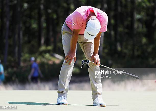 Adam Scott of Australia reacts to a missed eagle putt on the fourth green during the third round of The Barclays in the PGA Tour FedExCup PlayOffs on...