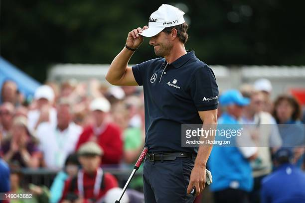 Adam Scott of Australia reacts to a missed par putt on the 18th green during the final round of the 141st Open Championship at Royal Lytham St Annes...